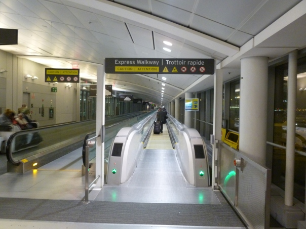 The ThyssenKrupp Express Walkway, claimed (but not cited) by Wikipedia as the world's fastest moving walkway - one operates in each direction to connect the main Terminal 1 with Pier E, which serves international but non-US flights.