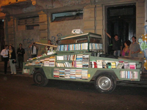 The night before going to the market, we were walking the streets of San Telmo on our way to dinner. And we happened across this, which I'm having a hard time describing. It's an old military vehicle that has been retrofitted with bookshelves. A tank/library? A Tankabrary? They were projecting a film onto the side of the building, but we couldn't figure out what was going on.
