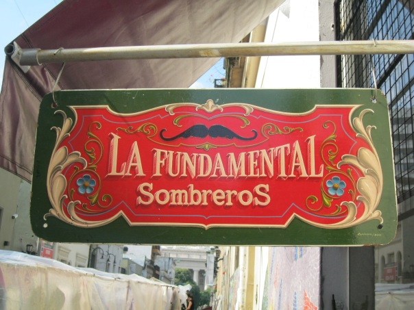 This is a very classic sign - with traditional paints, colors, and decoratif elements.