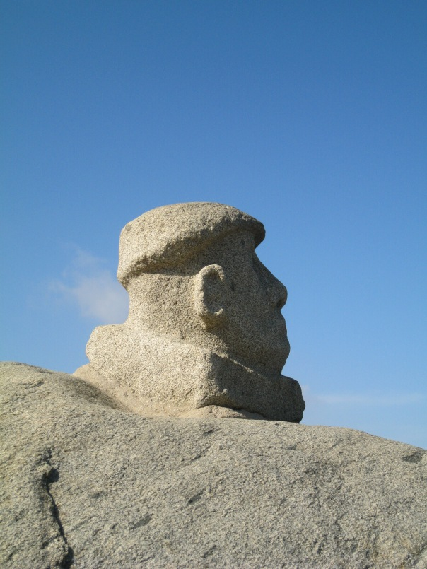 Someone has carved what appears to be Neruda's head into one of the rocks on the beach. He looks out over the ocean.