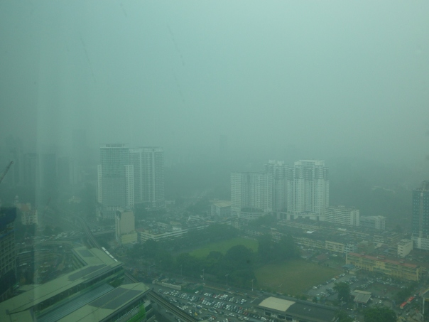 Unfortunately, forest fires in Sumatra (Indonesia) across the sea to the west are causing intense haze here, making it hard to see too far (this is the view from my room).