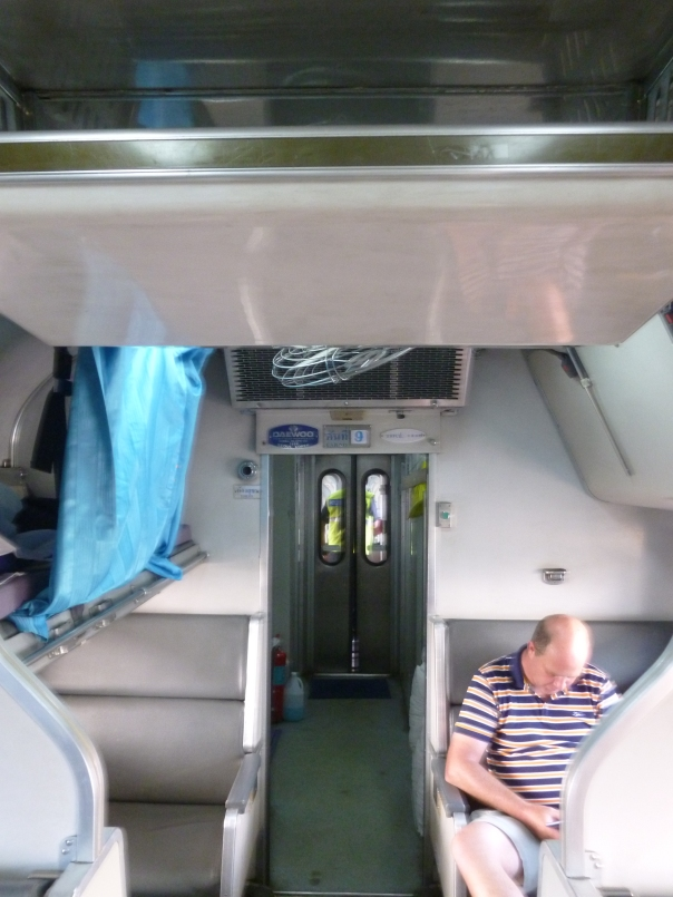 This is the inside of the Thai second-class sleeper - two facing seats by day, an upper and lower bunk by night (which is strictly defined as something like 8pm-6am).  As you can see, I wasn't the only Westerner on board!
