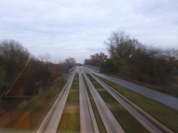 The guided busway from the top of a double-decker - the busway follows a former rail alignment through open countryside.