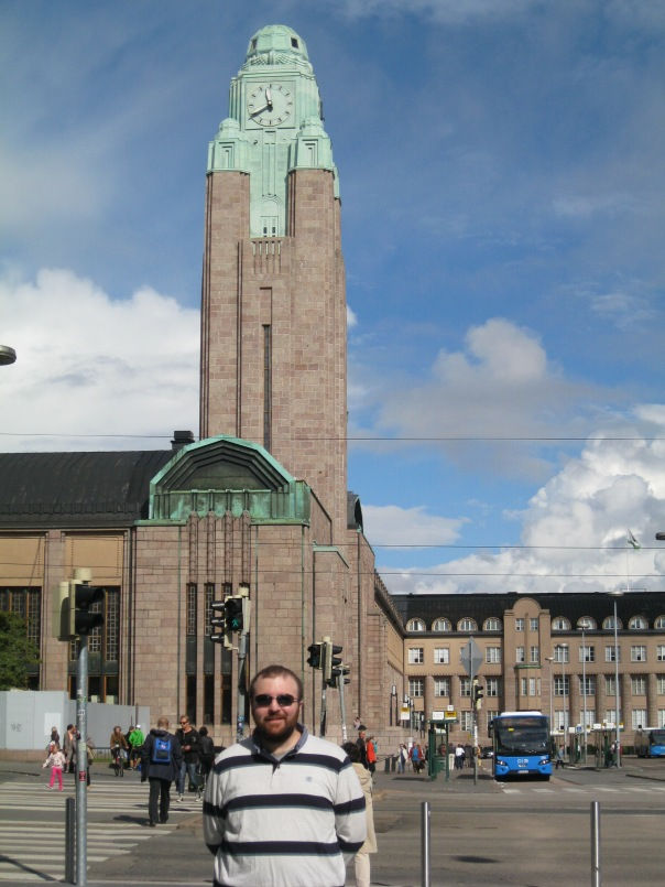 "Here I am in front of Helsinki Central Station (known as ""Helsinki C""), one of the most beautiful railway stations in the world (this one is from 1919). After so many trips through Helsinki Airport I finally got out and entered Finaland! Astrid and I had a great long weekend at the end of August, especially enjoying the very long daylight."