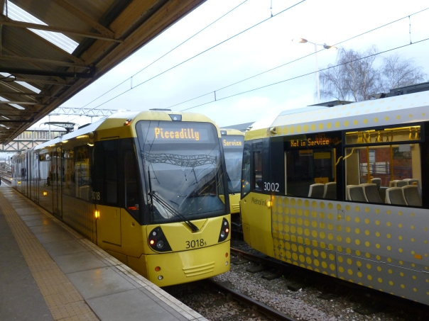 This is Manchester Metrolink - it started in 1992 and has grown significantly in the last couple of years, to a total of 57 miles and 92 stations with 7 different services that each typically operate every 12 min (with some overlapping). This photo is at Altrincham, the southern terminal of the original line, which was converted from a railway line.