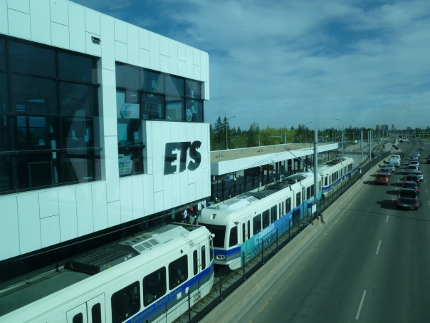 The Edmonton Transit System light rail line was the first modern one in North America, starting the trend that the San Diego Trolley brought to the US in 1981 and that has exploded primarily in the South and West of the US in the past 30 years. It is still small - a single 13-mile line with 15 stations - but is dense, carrying about the same number of riders as the San Diego Trolley that is 4x as big. Again, the key is frequency; every 5 min during rush hours, every 10 min all day weekdays and Saturdays, and every 15 min evenings and Sundays. It is really more of a light metro line, with four-unit trains in operation and the downtown section with 6 stations being underground. This picture is the Southgate Station, which opened in 2010 adjacent to a mall...even though it is in the middle of a large road it has good facilities with a transit center with bus connections and parking.