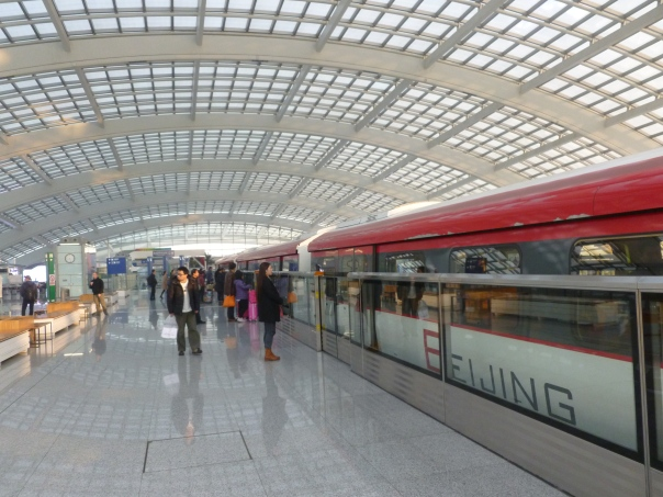 This is the impressive airport express train at Beijing Capital Airport's international Terminal 3, the second largest terminal in the world (after Dubai's Terminal 3). The airport as a whole is now the 2nd busiest in the world after Atlanta and growing fast and passing London Heathrow in 2010.