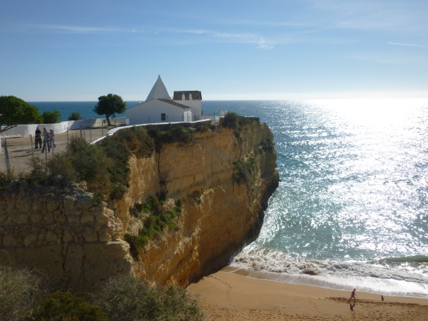 Looks like paradise, doesn't it? The beautiful blue sky, blue ocean, and shimmering sunshine of the Algarve. This is the Nossa Senhora da Rocha chapel in a picture-perfect setting.